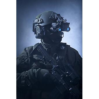 Special operations forces soldier equipped with night vision and an automatic weapon Poster Print