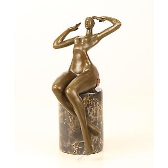 Bronze sculpture figure sitting naked