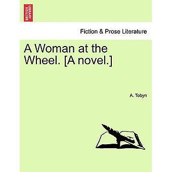 A Woman at the Wheel. A novel. by Tobyn & A.