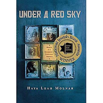 Under en röd himmel: memoar av en barndom i kommunistiska Rumänien