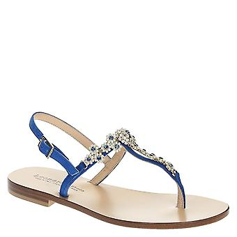 Ankle strap t strap flat sandals in blue suede leather with flower strass