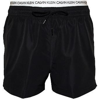 Calvin Klein dobbel-linning sportslige kutte badebukse, svart