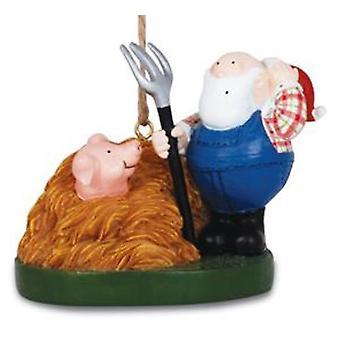 Santa de granjero con tridente y cerdo en pajar Navidad vacaciones ornamento