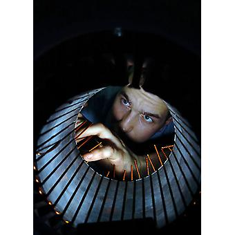 Electricians Mate inspects the windings of an electric motor for an air conditioning unit Poster Print by Stocktrek Images