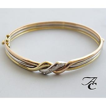 Gold tricolor bracelet with diamond