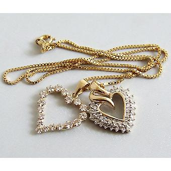 Gyllene hjärtan hängen med diamanter