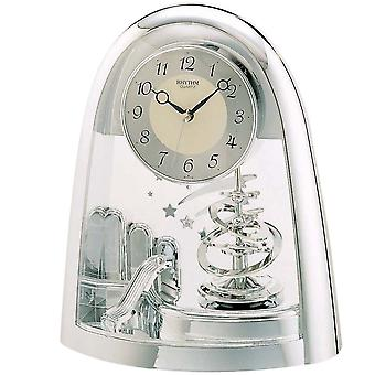 Table clock quartz watch silver with artfully crafted Rotary swing rhythm