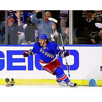 Carl Hagelin of the New York Rangers celebrates after scoring a goal in the first period during Game Four of the Eastern Conference Final in the 2014 NHL Stanley Cup Playoffs at Madison Square Garden