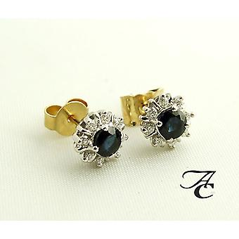Bicolor golden earrings with Sapphire and diamond