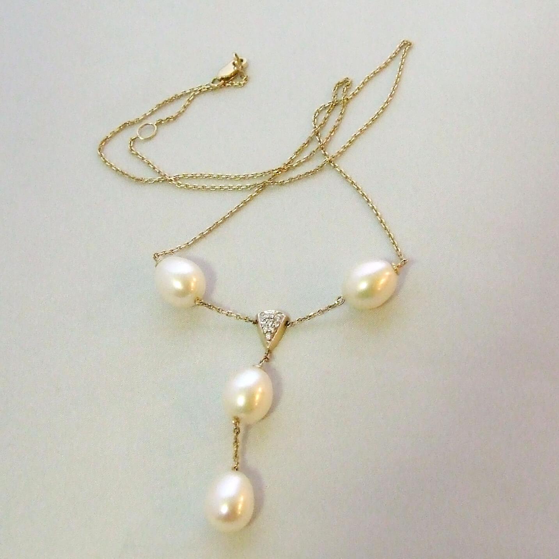 Gouden collier met parels en diahommet