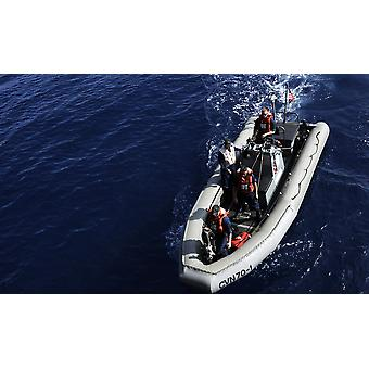 Sailors stand watch on a rigid-hull inflatable boat prior to a swim call Poster Print