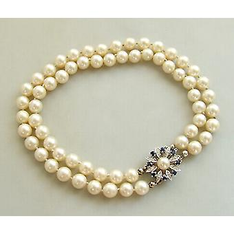 Pearl bracelet with Sapphire and diamonds slot