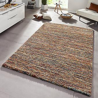 Design carpet deep pile for pile of gravel red brown mix