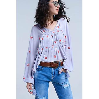 Lilac embroidered blouse with wide sleeve