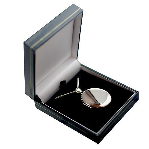 9ct white Gold 35x26mm plain oval Locket with a spigal chain