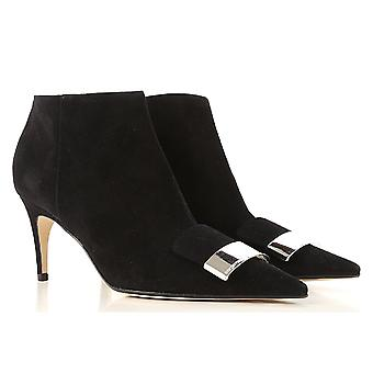 Sergio Rossi women's ankle boot in black suede with metal buckle on the tip