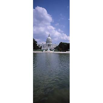 Reflecting pool with a government building in the background Capitol Building Washington DC USA Poster Print