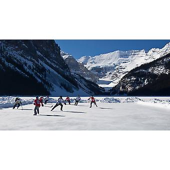Hockey players playing on the frozen Lake Louise Mount Victoria Banff National Park Alberta Canada Poster Print