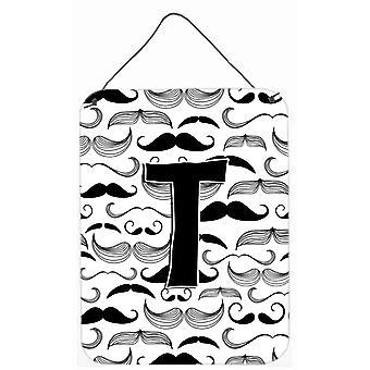 Письмо T усы первоначальной стены или двери висит отпечатков