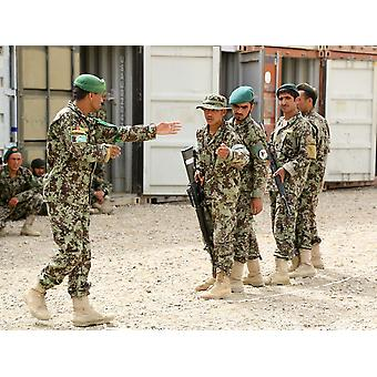 An Afghan National Army instructor instructs junior Afghan soldiers Poster Print