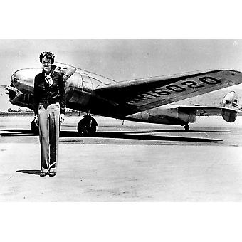 Amelia Earhart by an airplane Photo Print