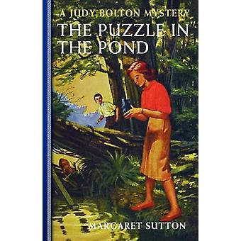 The Puzzle in the Pond by Sutton & Margaret