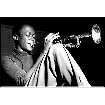 Miles Davis Sitting Sitting with trumpet Poster Poster Print