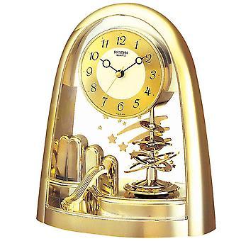 Table clock quartz watch gold tone with artfully crafted Rotary swing rhythm