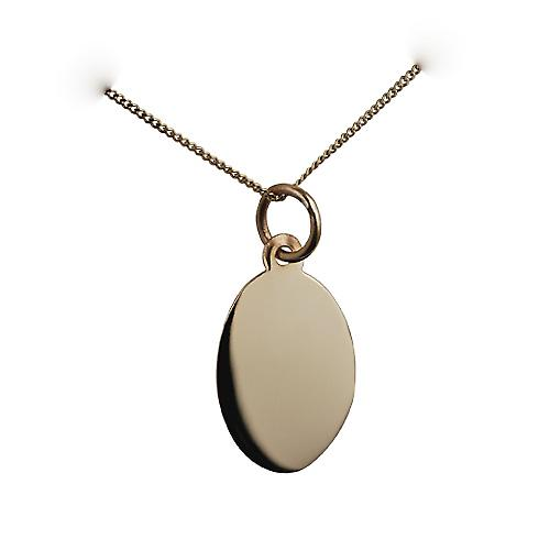 9ct Gold 16x11mm plain oval disc with a curb chain