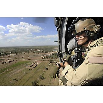 April 10 2009 - US Air Force Combat Rescue Officer scans for threats below during a mission in support of Operation Iraqi Freedom Poster Print