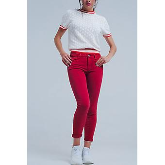 Red mid rise skinny jeans