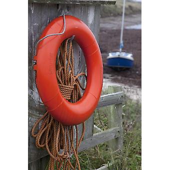 An Orange Life Preserver Ring And Rope Hanging On A Wooden Shed Wall Northumberland England PosterPrint