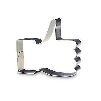 Galleta galleta cortador pulgar arriba como cortador de la galleta como símbolo