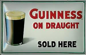 Guinness On Draught (glass) embossed steel sign